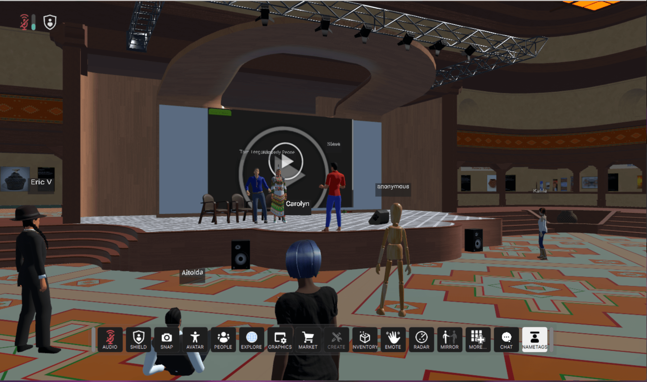 Listening to a speaker on the stage.